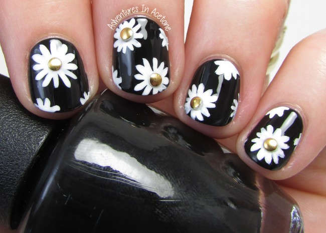 Black, white, and gold floral nail art 1